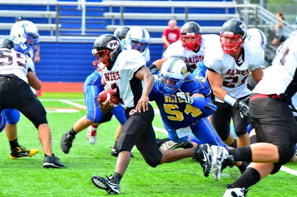 Patchogue-Medford running back Alistair Streat avoids the tackle