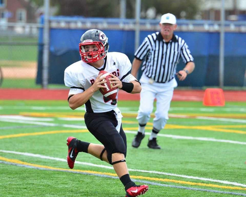 Patchogue-Medford quarterback Jack Keough drops back to make