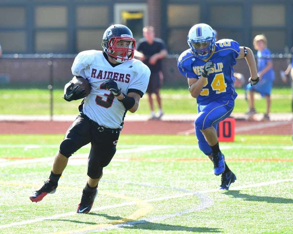 Patchogue-Medford running back Joe Altrui looks for some