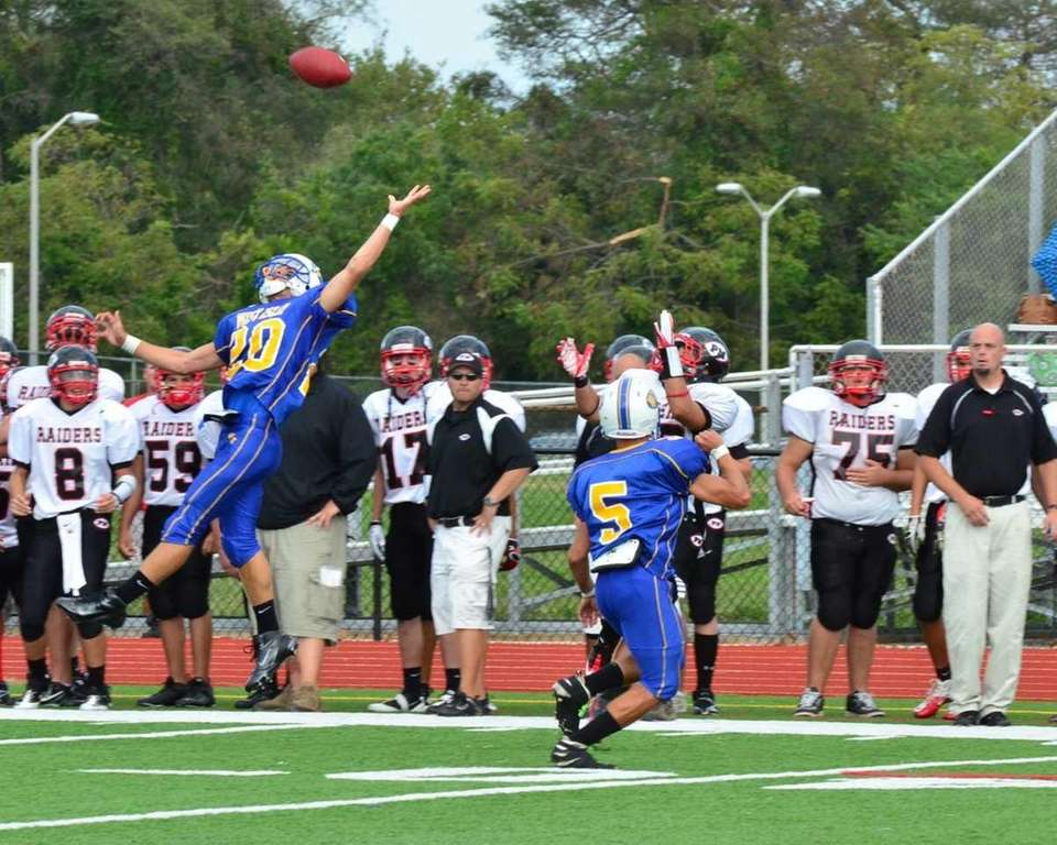West Islip's Ryan Weiczorek tries to a deflect