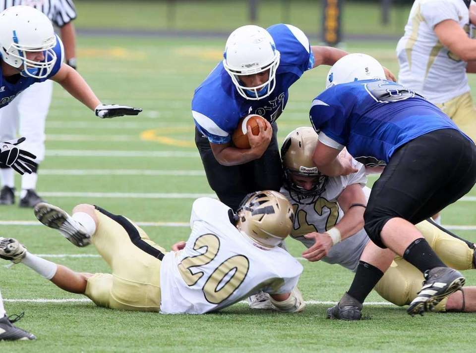 Julian Lee of Calhoun is tackled by Cody