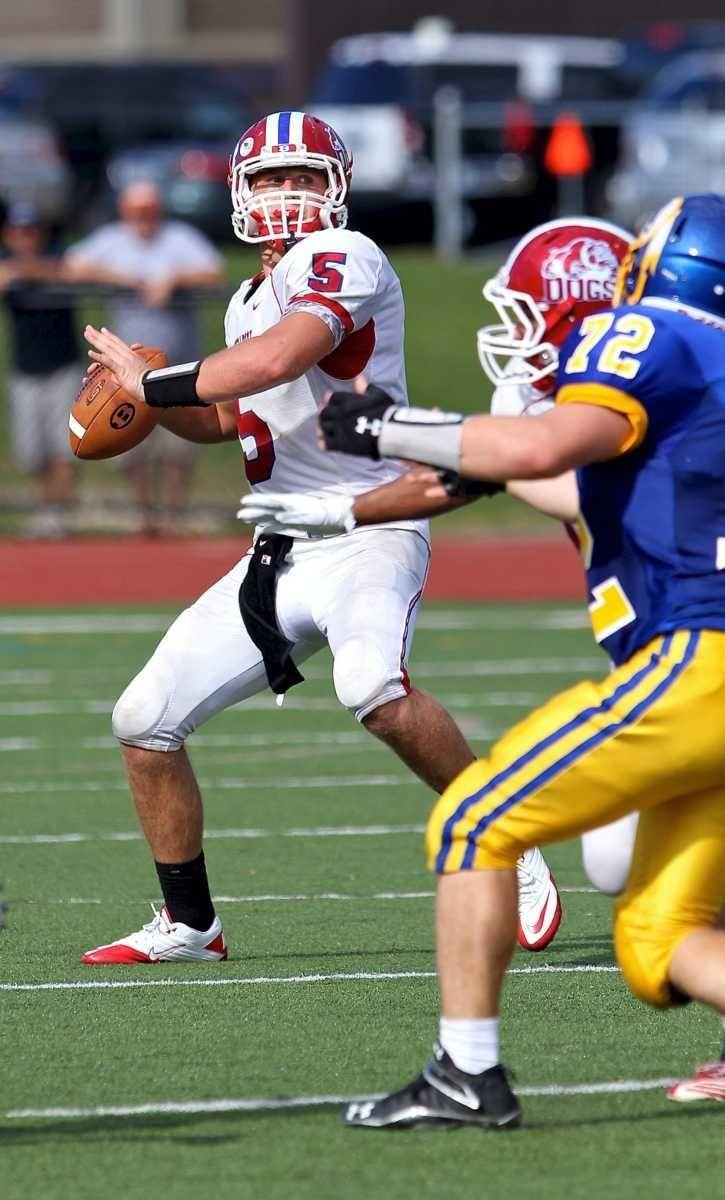 Bellport quarterback Justin Honce #5 readies the throw