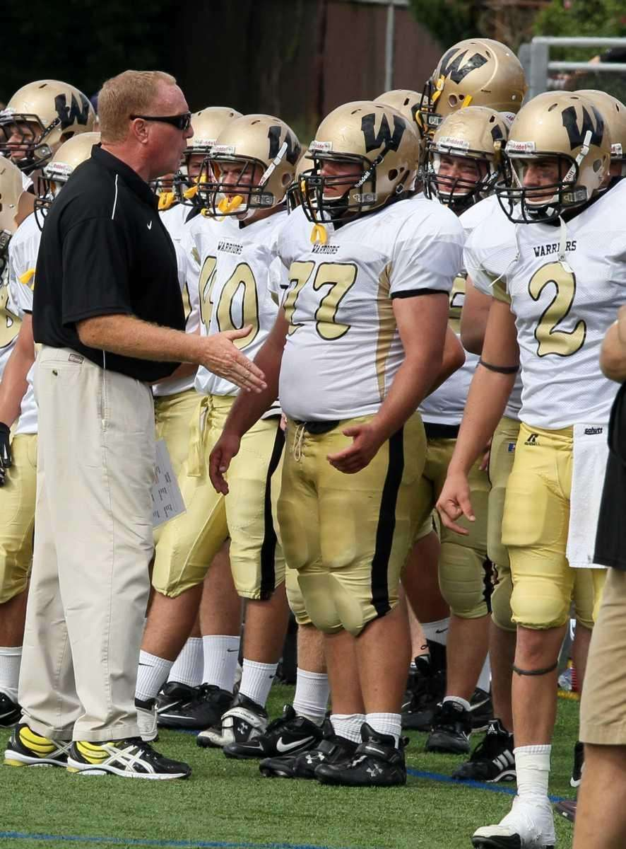 Wantagh head coach Tom Casey speaks to his