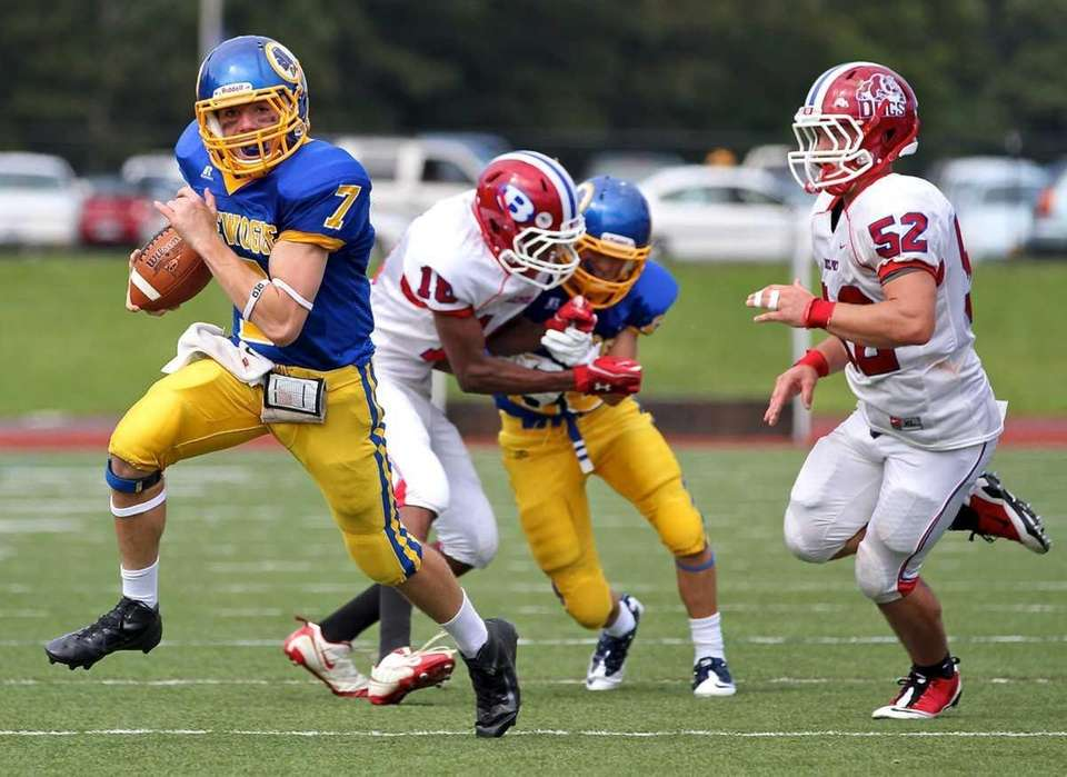 Comsewogue quarterback T. Keefe #7 moves the ball