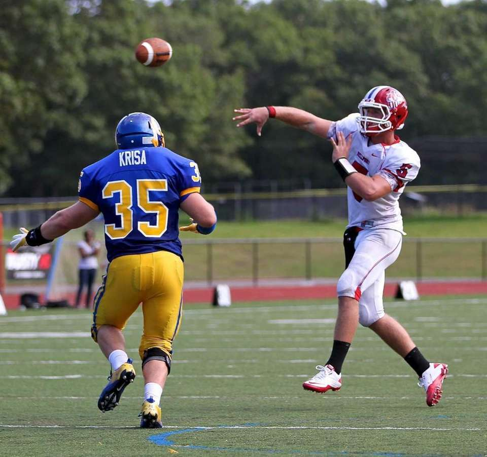 Comsewogue linebacker M. Krisa #35 moves in on
