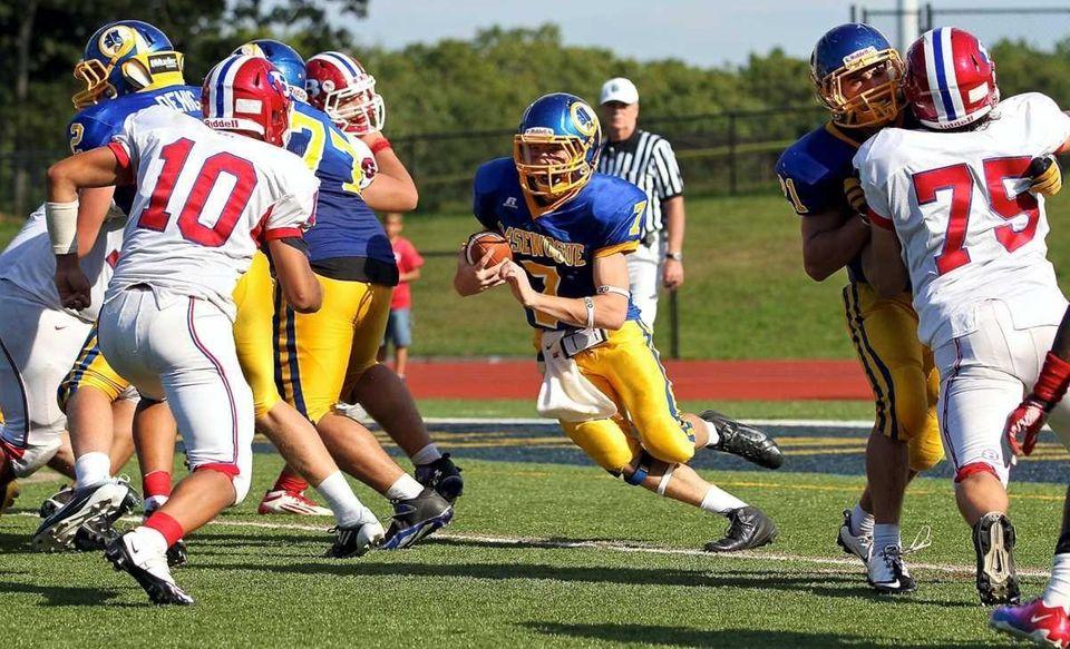 Comsewogue quarterback R. Keefe #7 scrambles out of