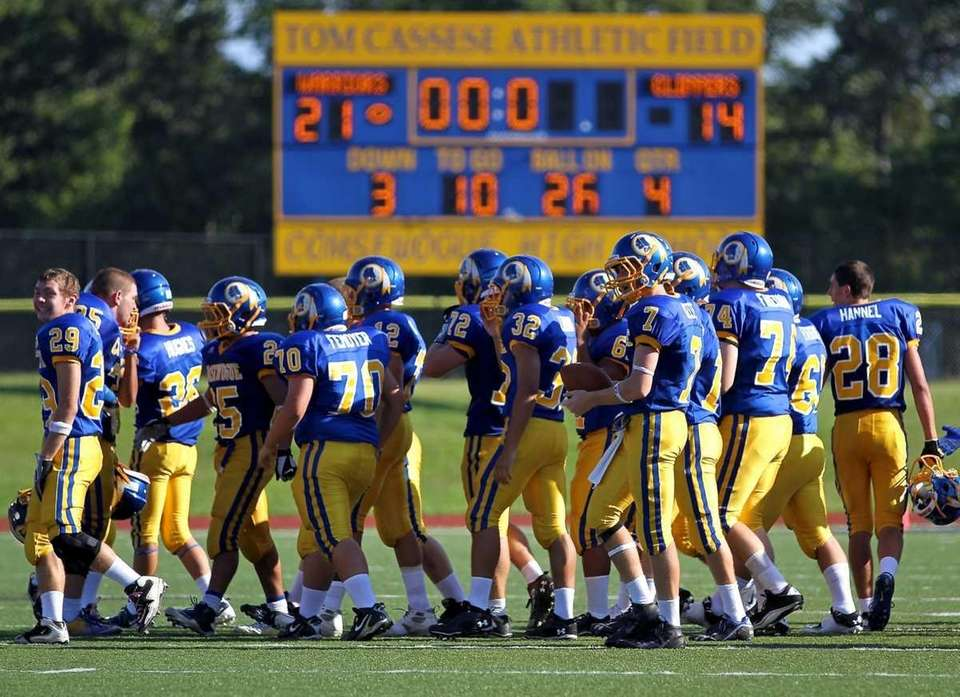 Comsewogue Warriors celebrate their victory over the Bellport