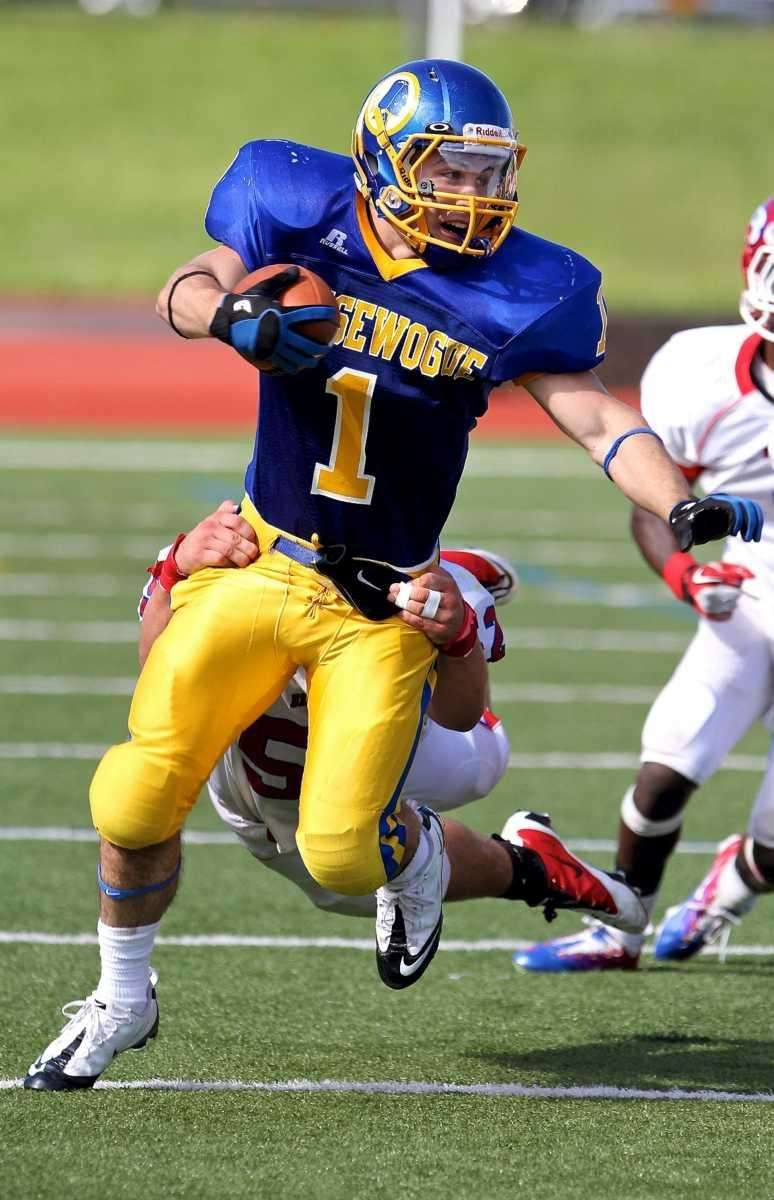 Comsewogue running back Anthony Marone #1 drags Bellport