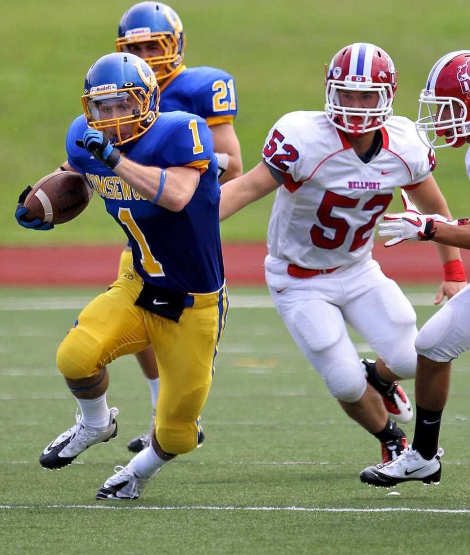Comsewogue running back Anthony Marone #1 scrambles for