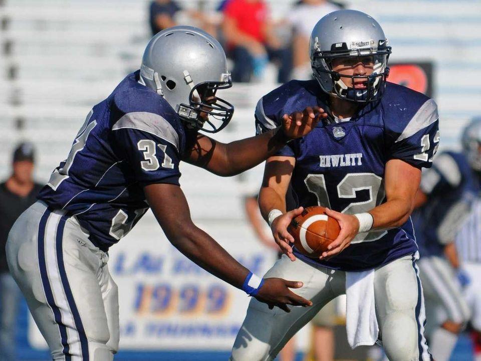 Hewlett High School quarterback #12 Mark Rizzo, right,