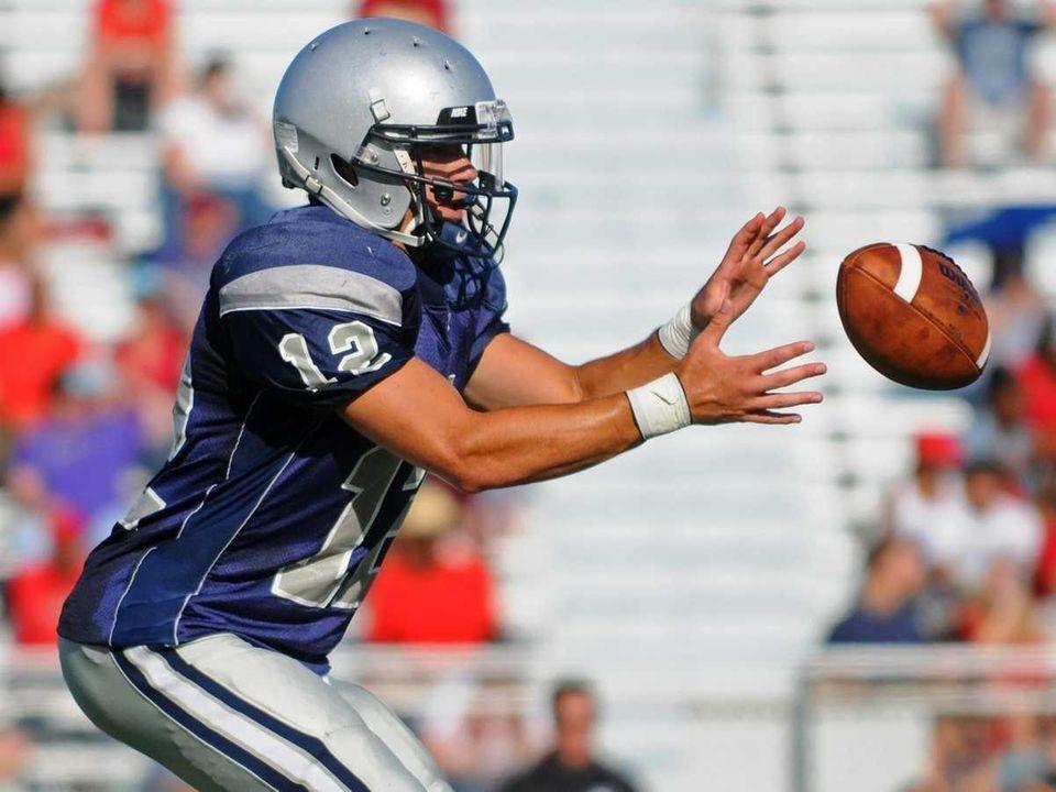 Hewlett High School quarterback #12 Mark Rizzo takes