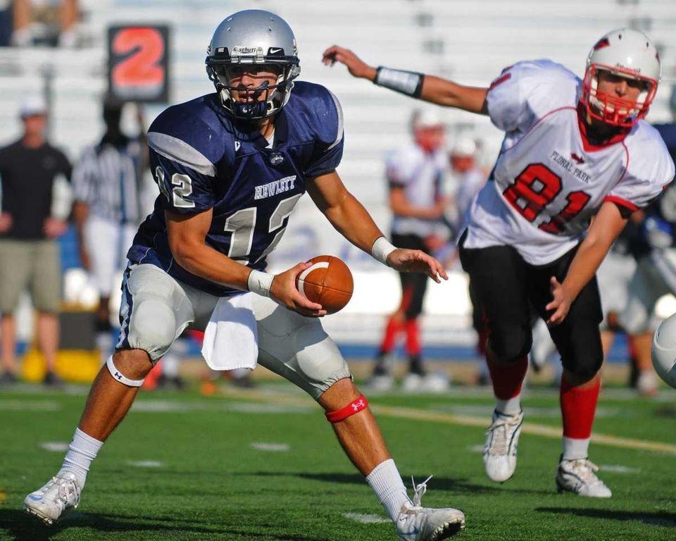 Hewlett High School quarterback #12 Mark Rizzo, left,