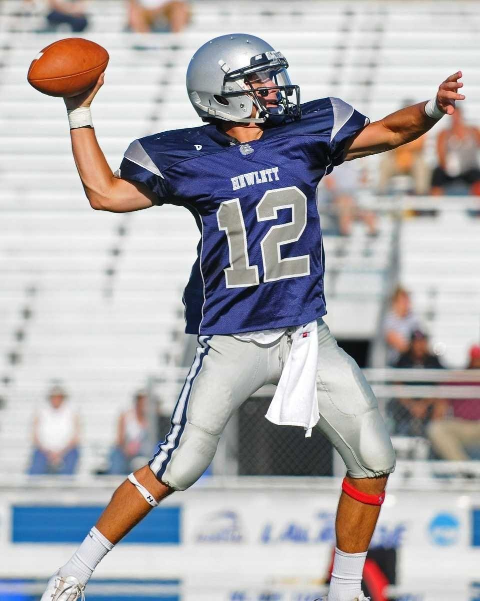 Hewlett High School quarterback #12 Mark Rizzo throws