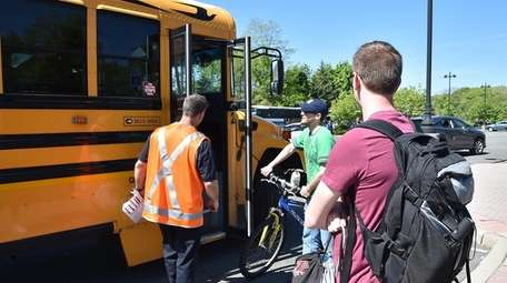 Commuters get on buses in Speonk heading east