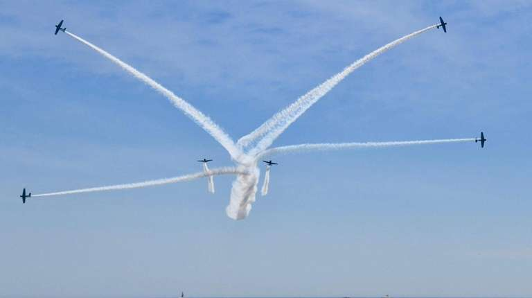 Planes fly out of formation as crowds watch