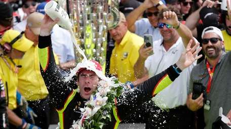 Simon Pagenaud, of France, celebrates after winning the