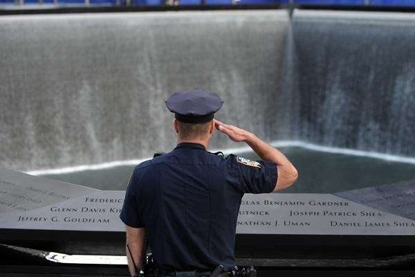 A New York City police officer salutes at