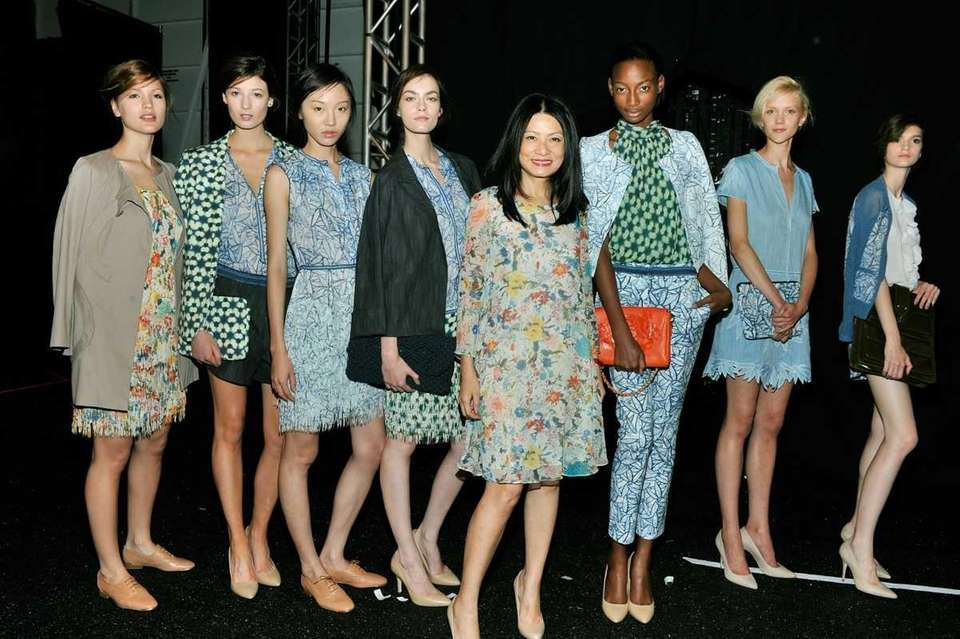 Designer Vivienne Tam (C) poses with models at