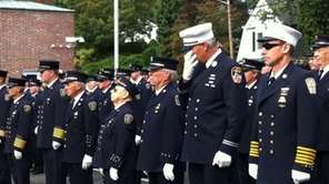 Capt. Dave Loper reacts during a 9/11 memorial