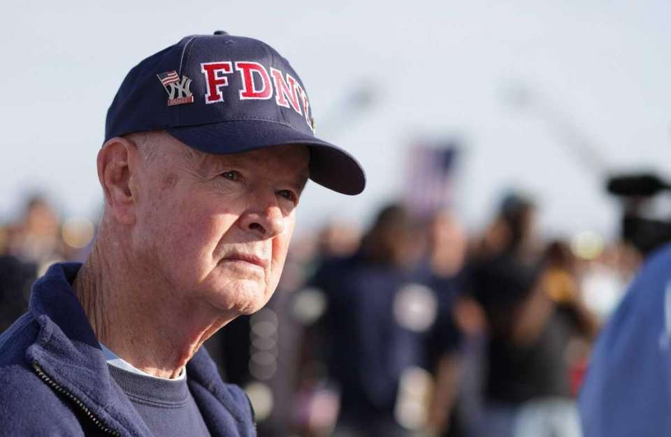 Bob Beckwith watches a memorial service for the