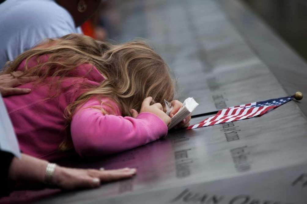 Family members at the names etched at the