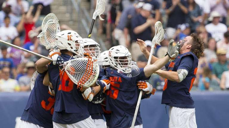 The Virginia Cavaliers celebrate their win against the