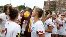 Members of the Maryland Terrapins celebrate following their