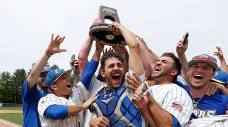 NYIT players, led by catcher Matt Malone, center,