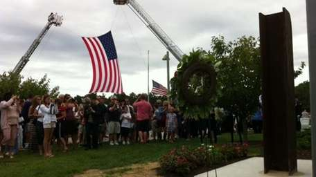 Eastport South Manor residents gather around the 9/11