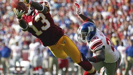 Washington Redskins wide receiver Anthony Armstrong is stopped