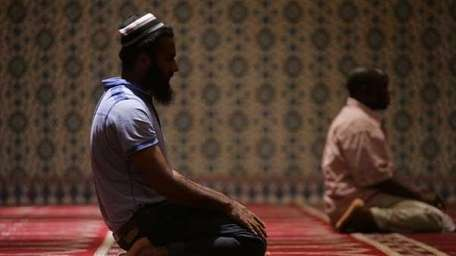 Muslims pray at the The Islamic Cultural Center