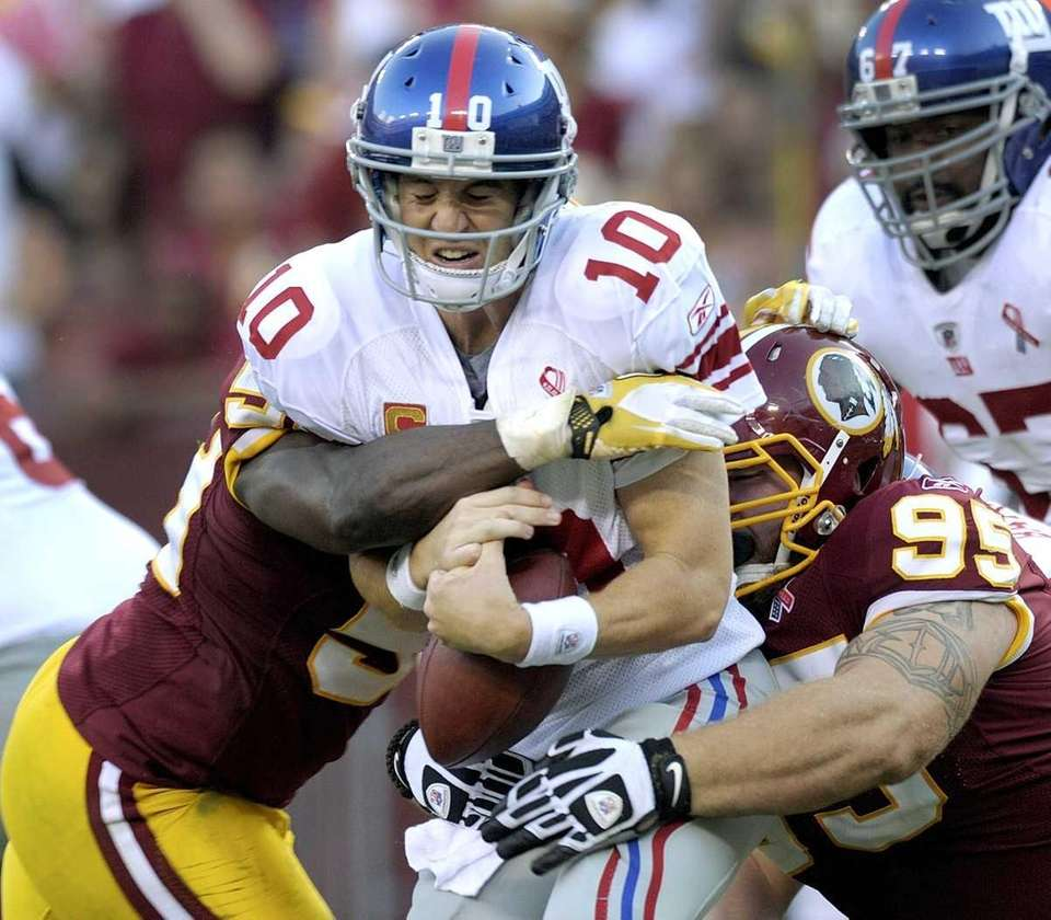 New York Giants quarterback Eli Manning is sacked
