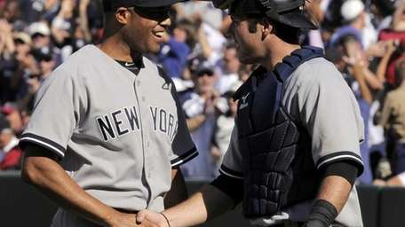 New York Yankees relief pitcher Mariano Rivera, left,