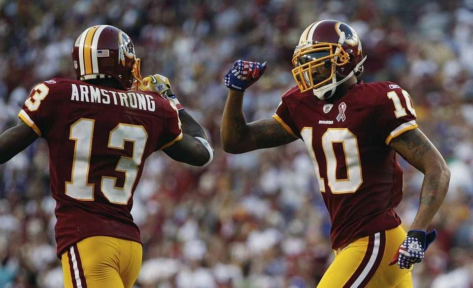 Washington Redskins wide receiver Jabar Gaffney, right, celebrate