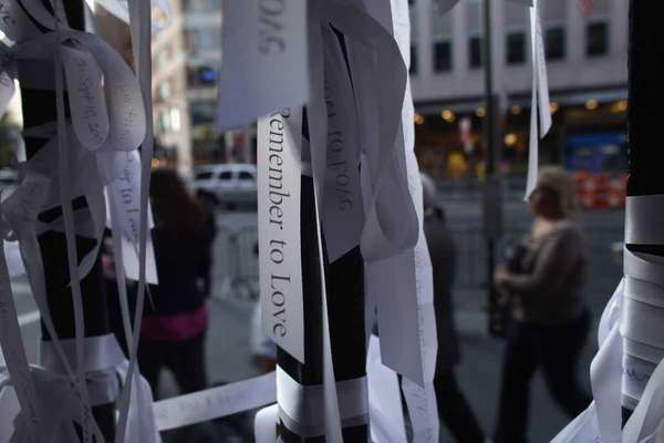 Ribbons of remembrance are viewed on the iron