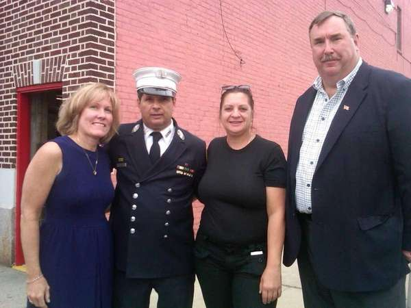 From left, Carol Murphy, fire Capt. Vincent Ungaro,