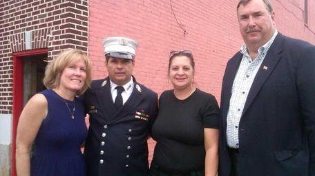 From left, Carol Murphy, fire Capt. Vincent Ungaro,