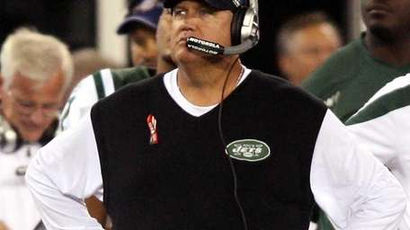 Rex Ryan stands on the sideline during the