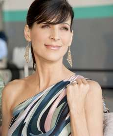 Perrey Reeves as Mrs. Ari in the final