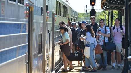 Passengers board a westbound Long Island Rail Road