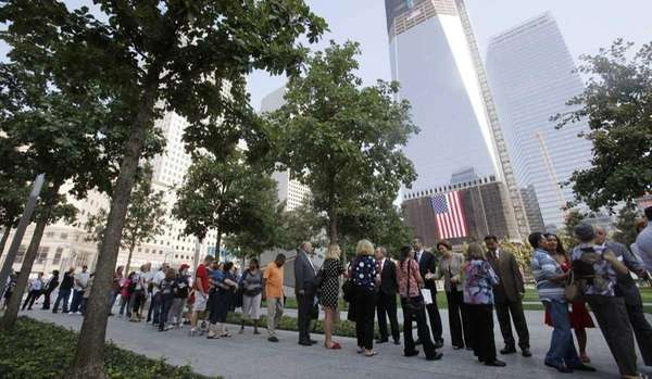 Visitors line up to enter the 9/11 memorial