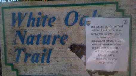 A sign outside the White Oak Nature Trail