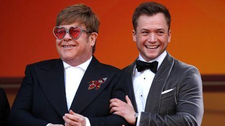 Rocker Elton John and actor Taron Egerton attend