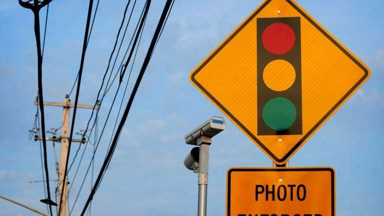 A sign and red-light camera on Middle Country