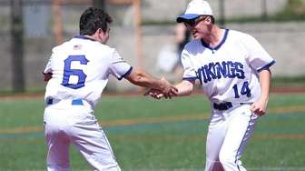 Port Washington's (L-R) Chris Caprariello and winning pitcher