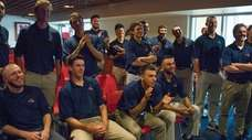 Stony Brook baseball players and coaches watch at