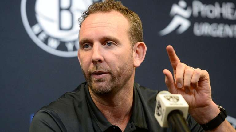 Nets general manager Sean Marks speaks with reporters