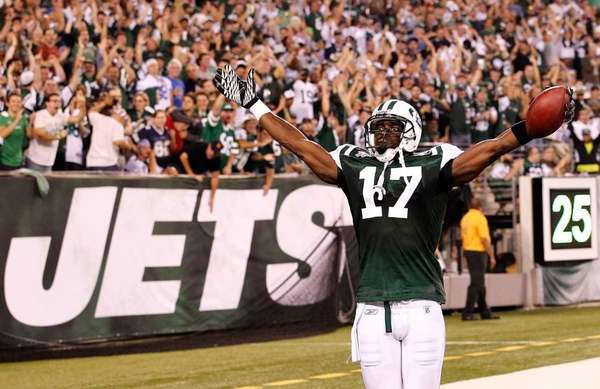 Plaxico Burress celebrates after he scored a 26-yard