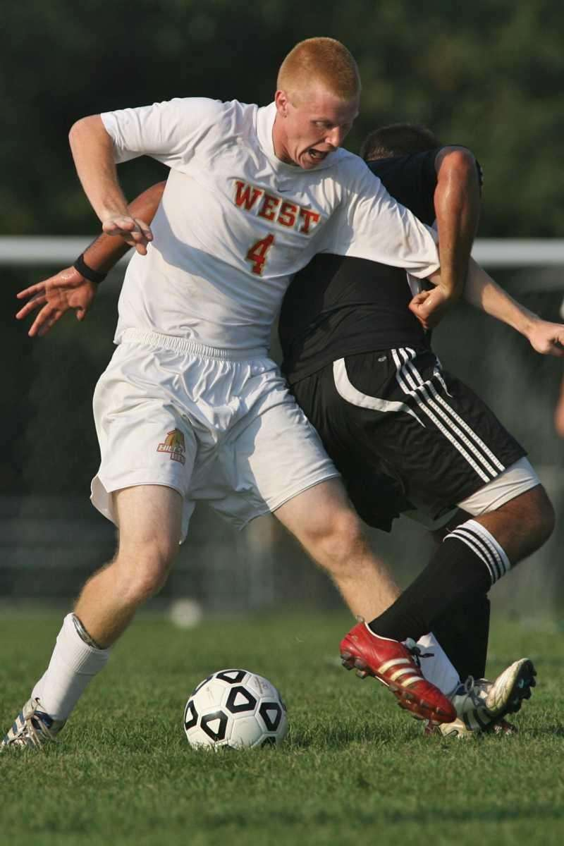 Half Hollow Hills West's Kevin Stanis fights for