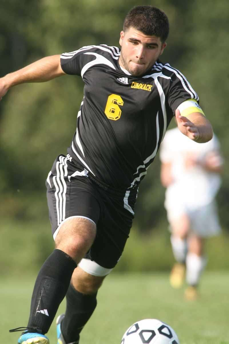 Commack's Mike Biondo moves the ball against Half